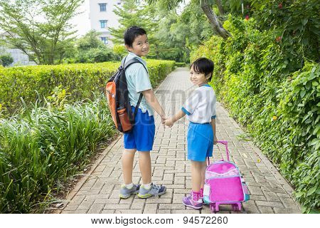Two Siblings Going To School Together
