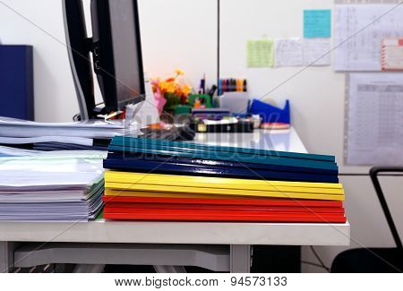 Stack Of Documents And Plastic Ridge Folders