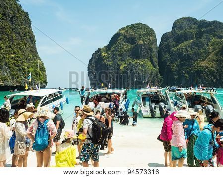 PHI PHI ISLANDTHAILAND-April 21 2015: Tourists on the wonderful Maya beach of Phi Phi Leh island Thailand on April 21 2015.