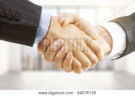 Handshake In A Light Room
