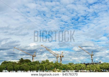 Crane Construction In The City Under The Blue Sky