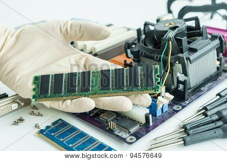 Ram On Repairman Hand To Check And Repair