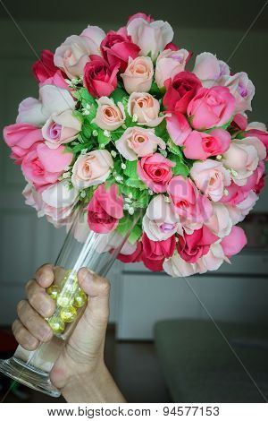 Man Hand Holding Colorful Bouquet Rose