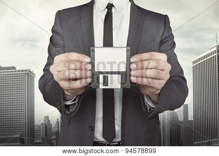 Businessman holding diskette in hands