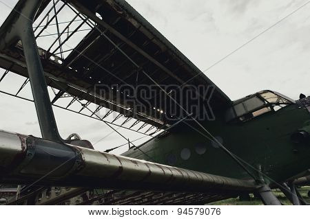 old soviet airplane against dark gray sky