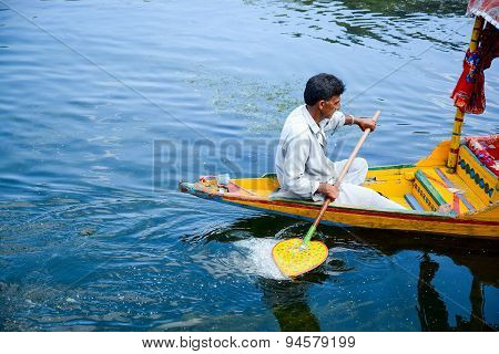 Local People Row The Shikara In Dal Lake