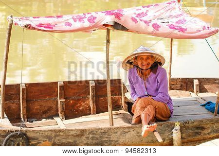 Woman In The Boat At Hoi An, Vietnam