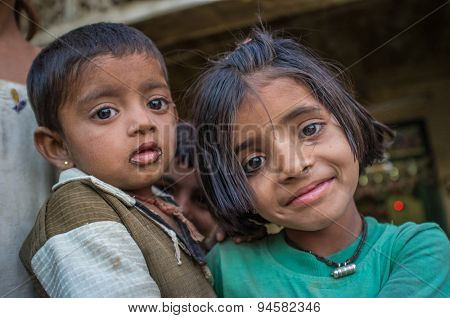 GODWAR REGION, INDIA - 12 FEBRUARY 2015: Young girl holds baby. Loss of tradition gains pace from every new generation. Rabari or Rewari are an Indian community in the state of Gujarat.