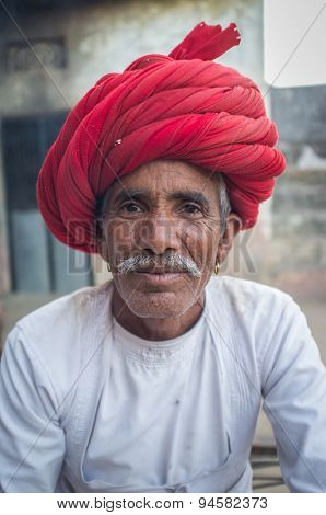 GODWAR REGION, INDIA - 12 FEBRUARY 2015: Rabari tribesman with traditional turban and clothes. Rabari or Rewari are an Indian community in the state of Gujarat.