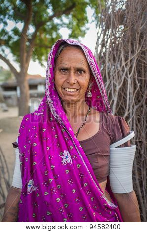 GODWAR REGION, INDIA - 12 FEBRUARY 2015: Tribeswoman decorated with traditional tattoos on face,  jewelry and upper arm bracelets. Rabari or Rewari are an Indian community in the state of Gujarat.