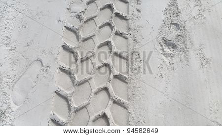 Wheel Track And Footprints On The Sand