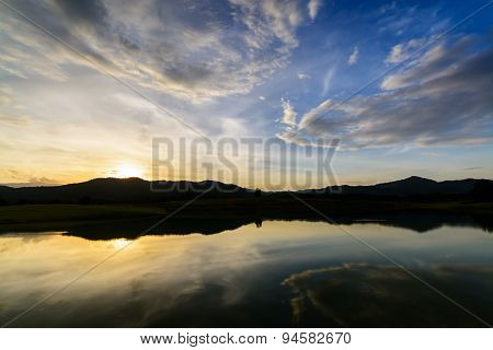 Mountain At Sunset With Peaceful Lake Reflection