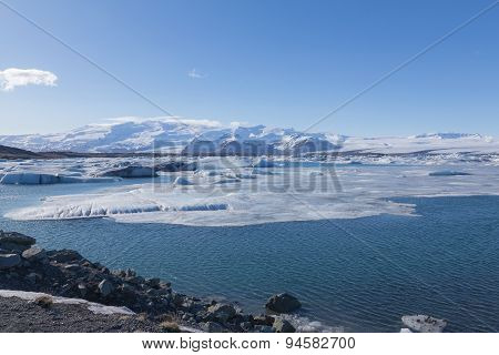 Winter lagoon with clear blue sky