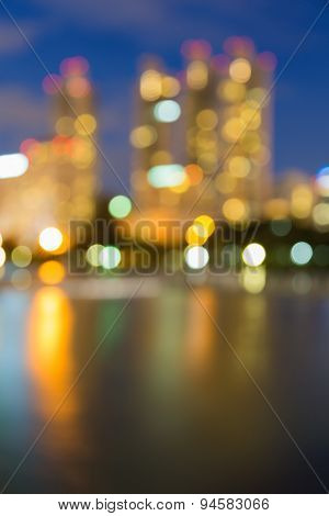 Abstract blur bokeh, river water front city lights at twilight time