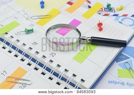 Magnifying Glass With Colorful Post It Notes And Pin On Diary Page