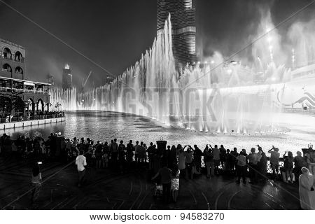 DUBAI, UAE - OCTOBER 15, 2014: The Dubai Fountain. The Dubai Fountain is the world's largest choreographed fountain system set on the 30-acre manmade Burj Khalifa Lake