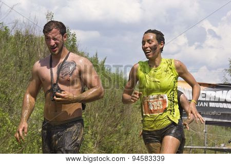 Couple Of Participant At An Italian Mud Run