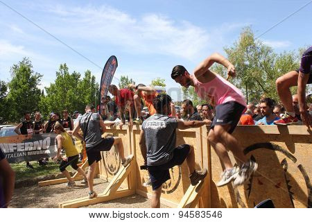 Group Of People Jumping Over An Obstacle
