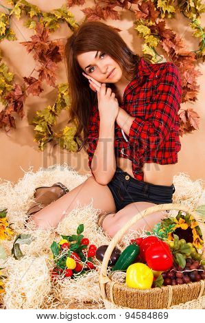 Cute Young Farmer Girl Sitting In A Hay With A Harvest