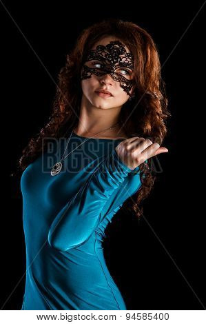 Beautiful Young Woman In A Black Mask And A Green Dress