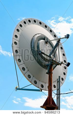 Old Satellite Dish On Blue Sky Background