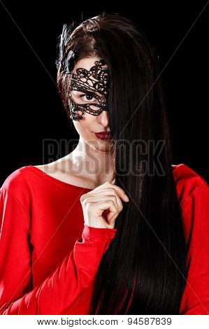 Beautiful Young Woman Sitting In A Black Mask