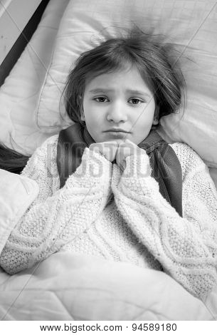 Black And White Portrait Of Girl With Flu Lying In Bed