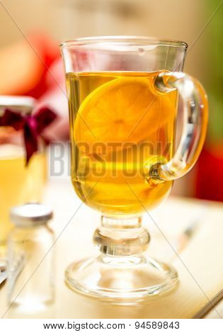 Closeup Photo Of Hot Tea With Lemon In Transparent Glass