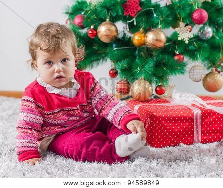 Adorable Baby With Christmas Present