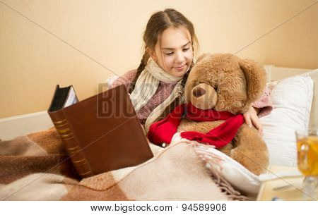 Portrait Of Brunette Girl Telling Story To Teddy Bear At Bed