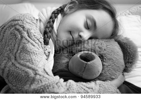 Black And White Portrait Of Cute Dreaming Girl Hugging Teddy Bear