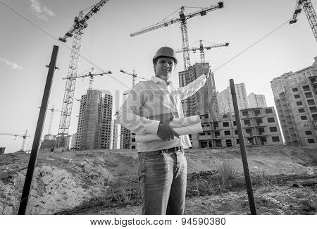 Black And White Portrait Of Architect Posing On Building Site