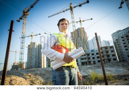 Construction Manager Posing On Building Site At Sunny Day