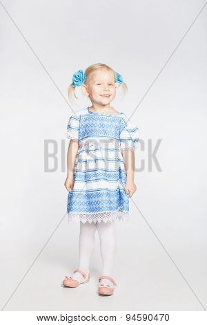 Cute Smiling Girl On A White Background