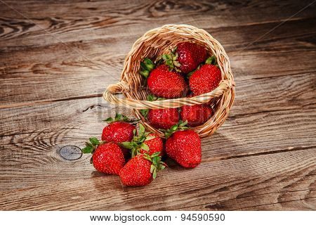 Strawberries In The Basket Poured Into The Old Board