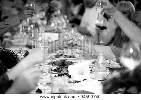 Black And White Photo Of Celebrating People Clinking Glasses