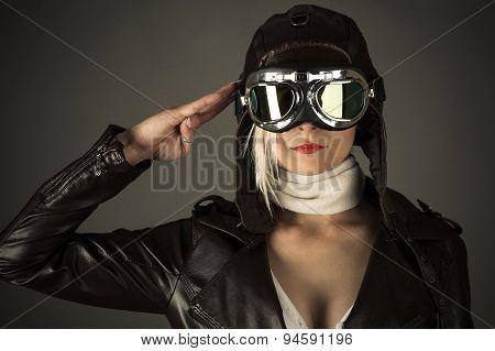 woman pilot saluting