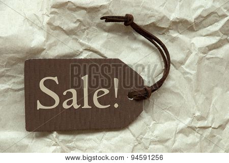 Brown Label With Sale Paper Background