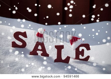 Christmas Sale Snowflakes Santa Hat On Snow