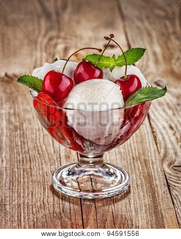 Ice Cream With Fruits And Cherries On Old Boards