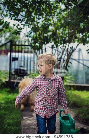 Beautiful boy gardening. Garden. Vegetables. Outdoors portrait