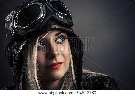 portrait of a beautiful girl in aviator helmet