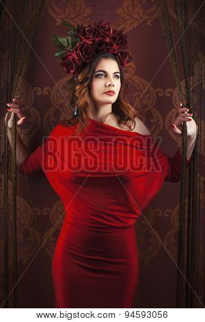 Girl In Red Dress Standing With Wreath Of Flowers
