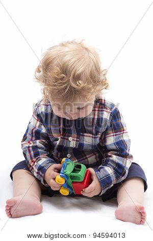 Little Baby Boy Playing With Toy