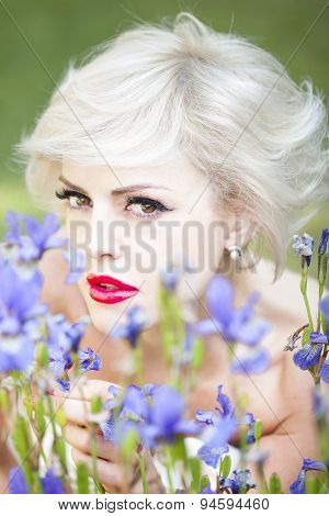 Portrait Of Woman With Iris Flowers