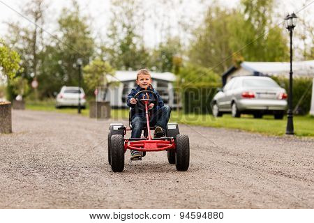 Boy Driving On Buggy Cart