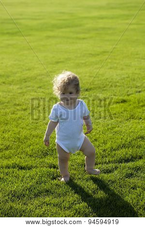Curly Boy On Green Grass