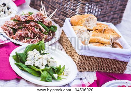 Italian bread, cheese and sausage on a picnic