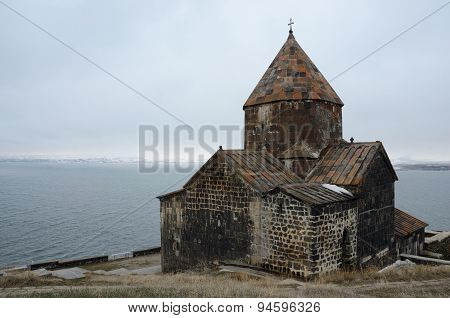 View of Surb Arakelots church in winter,Sevanavank orthodox monastery,northwestern shore of Lake Sev