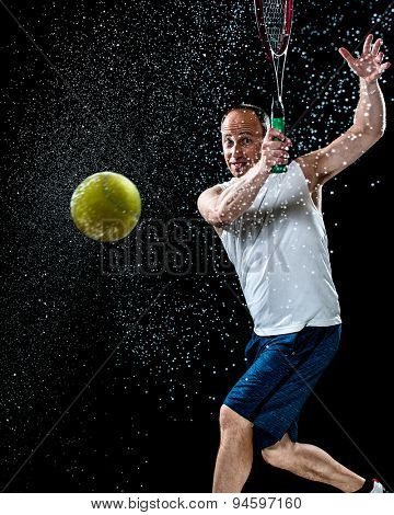 Tennis action shot. Forehand. Studio shot over black.